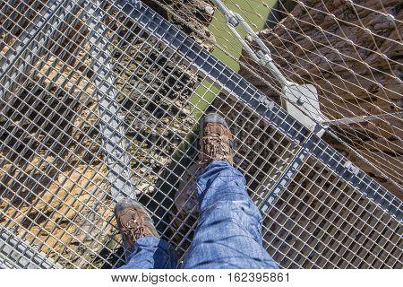Trekking shoes over suspension bridge at Caminito del Rey path Malaga Spain