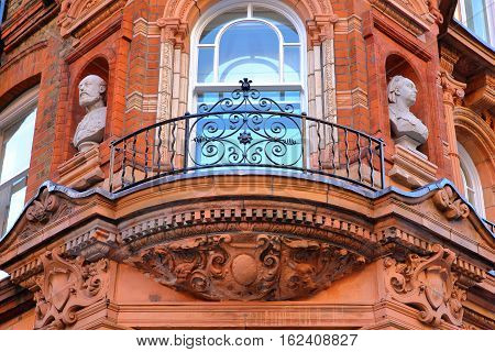 LONDON, UK: Details of red brick Victorian houses facades in the borough of Westminster