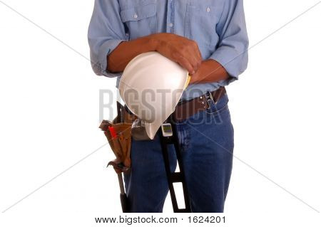 Carpenter Holding Level & Hardhat