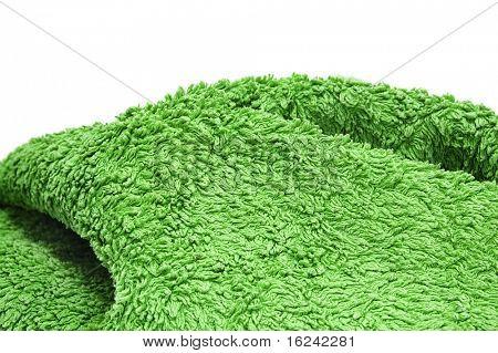 una toalla verde sobre un fondo blanco