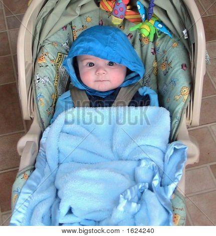 Baby Bundled In Winter Coat
