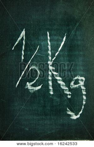 half a kilogram written with a chalk on a blackboard