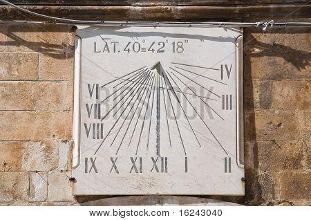 Sundial on brickwall.