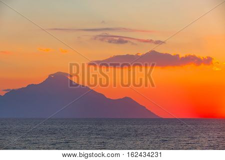 Silhouette of mount Athos at sunrise or sunset and sea panorama in Greece