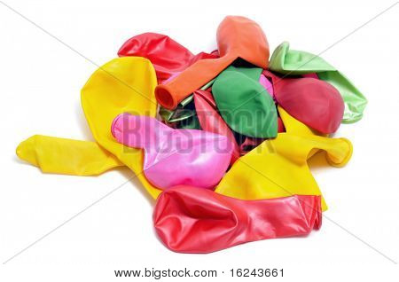 close up of some deflated balloons of different colors