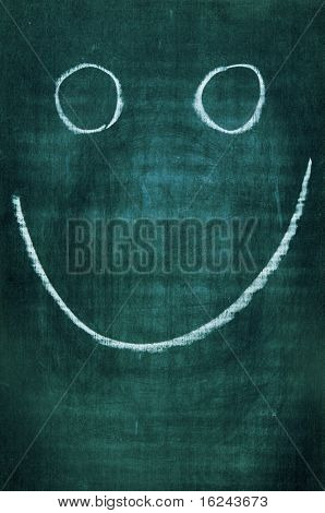 a smile drawn with a chalk on a blackboard