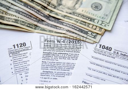Tax Form W4 1120 1040 with dollar
