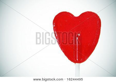 a heart-shapped lollipop on a degraded background