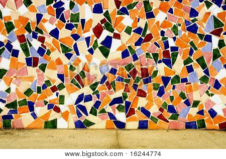 a wall made with an abstract pattern made with mosaic bits
