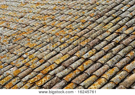 detail of an old roof made with tiles from an mediterranean village