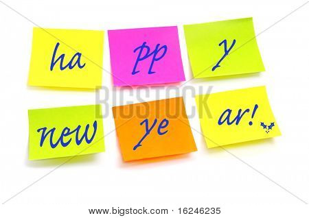 happy new year written in post notes of different colors