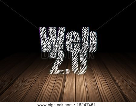Web development concept: Glowing text Web 2.0 in grunge dark room with Wooden Floor, black background