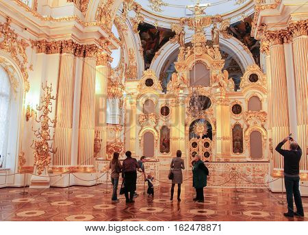 Gatchina, Russia - 3 December, A group of visitors in the hall with iconostasis, 3 December, 2016. Visit the Museum Reserve Gatchina Palace.