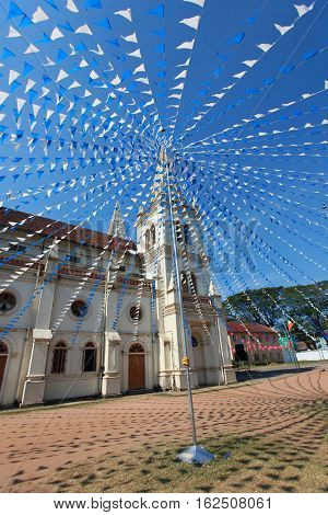 Santa Cruz Basilica in Cochin decorated for Christmas flags India