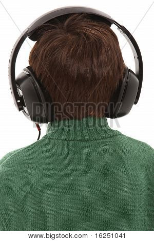 Child Wearing Head Phones With Back Turned With Clipping Path.