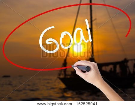 Woman Hand Writing Goal  With A Marker Over Transparent Board