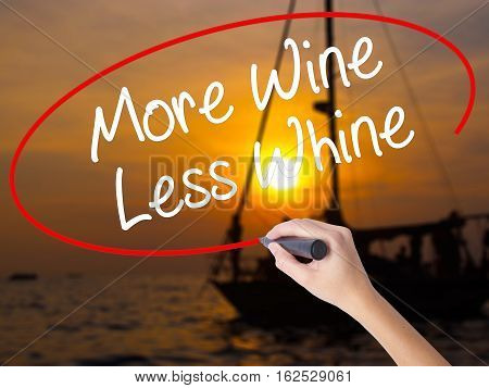 Woman Hand Writing More Wine Less Whine With A Marker Over Transparent Board