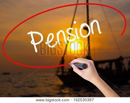 Woman Hand Writing  Pension With A Marker Over Transparent Board