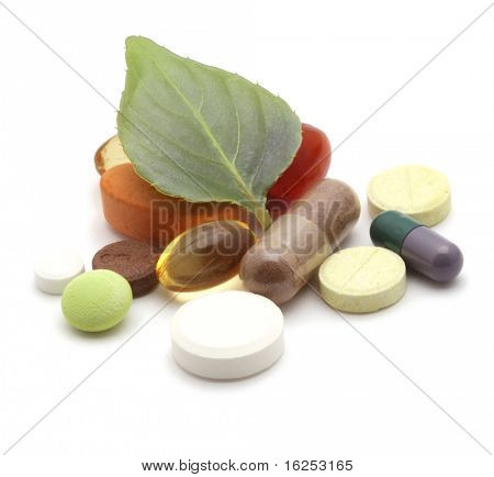 vitamins, tablets and pills and green leaf