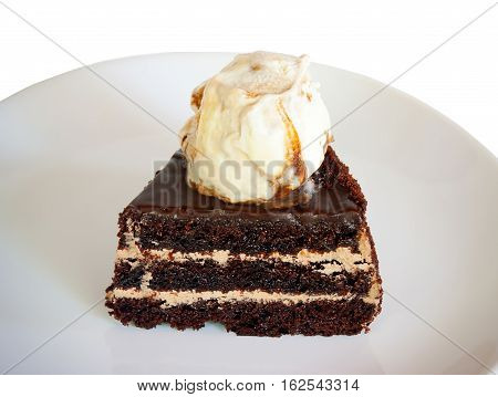 Chocolate cake with ice cream isolated on white background