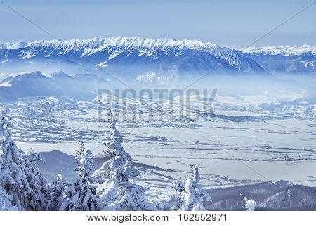 Winter Landscape  Over The Piatra Craiului Mountains In Brasov County, Romania.view Of The Carpathia