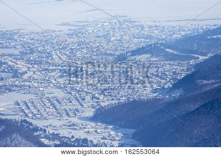 Panorama Of The City Of Brasov Covered By Snow In The Winter Season, Romania