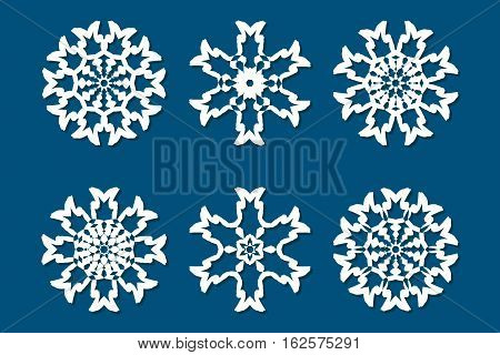 Snowflake set. Laser cut pattern for christmas paper cards wood carving paper cutting design elements scrapbooking. Collection of different white snowflakes on blue background