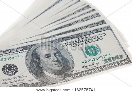 One hundred dollar bills in close up photo U.S. currency.