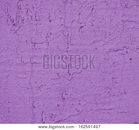 Plaster, plaster lilac color on a concrete wall. Stucco purple wall background or texture. Plaster, plaster texture, plaster background. Lilac wall. Color plaster.