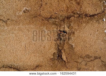 Plaster, plaster natural color on a brick wall. Stucco beige wall background or texture. Plaster, plaster texture, plaster background. Natural plaster wall. Natural stucco wall.