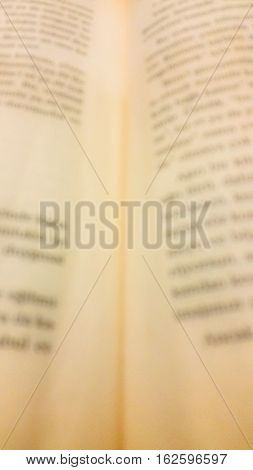Blurry view of an old opened book pages