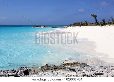 The view of a beach on an uninhabited Half Moon Cay island (The Bahamas).