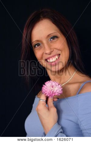 Portrait Of A Pretty Woman With A Flower