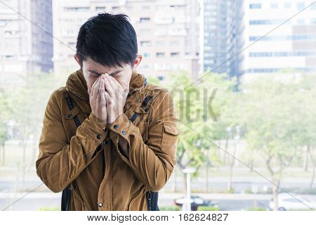 Asian business man feeling unwell at outdoor