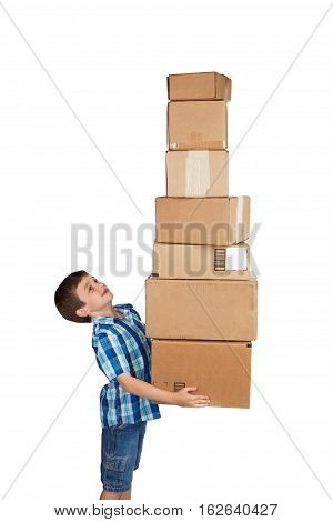 Young boy struggling with a tower of cardboard boxes isolated on white background