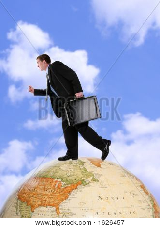 Business Man On Globe