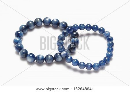 Lucky blue stone bracelet on white background.