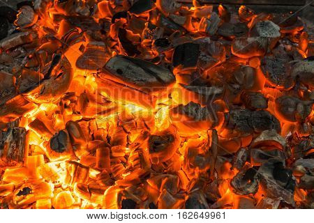 close up of red light of live coals