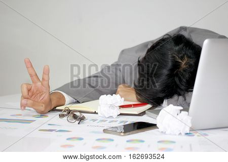 Businessman Sleeping At His Desk Working Over A Laptop After He Work All Day All Night, Tried Overwo