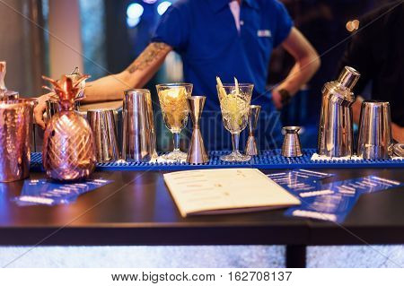 Barman show. Bartender is making cocktail at night club