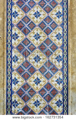 A tiled wall background in the downtown of Evora. Portugal.