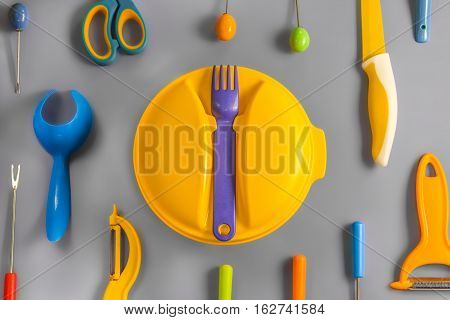 Flat lay set of colour plastic ware