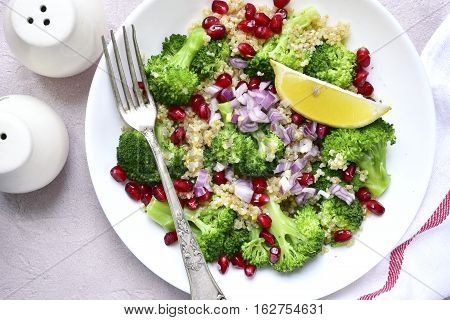 Quinoa Salad With Broccoli,red Onion And Pomegranate.top View.