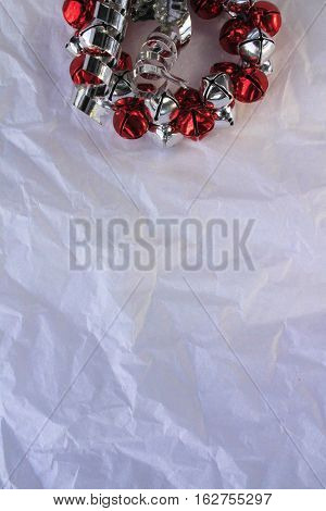 Red and Silver Jingle Bells Wreath on a White Background