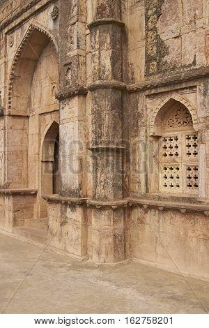 MANDU, MADHYA PRADESH, INDIA - NOVEMBER 18, 2008: Detail of carved stonework of Darya Khan's tomb in the hilltop fortress of Mandu. 16th Century AD