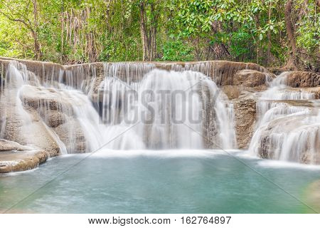 Beautiful waterfall cascades in Erawan National Park in Thailand.