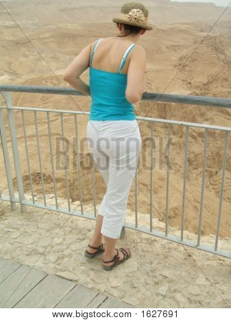 Tourist Looking At Mountains Of Sand In Massada/Israel