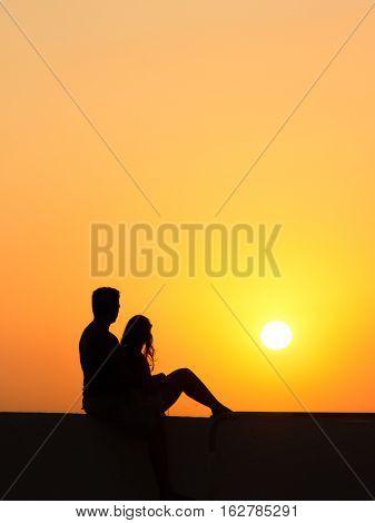 Couple Enjoying Santorini Island From The Firostefani Church Balcony