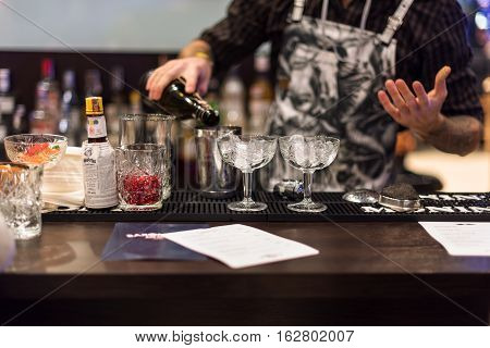 KIEV, UKRAINE - 30 OCTOBER, 2016: Bartender is making cocktail on barman festival