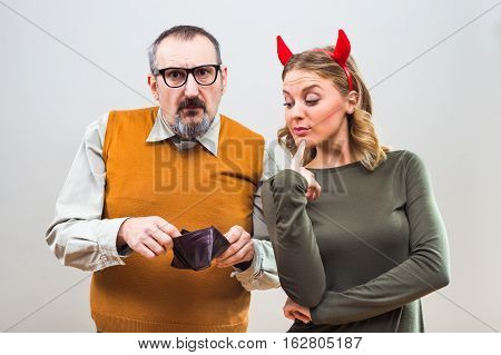 Nerdy man is uncertain,he is thinking does his wife love more him or his money.
